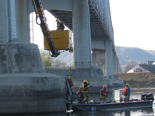 Workers install an active sonar system on a bridge in Winona. (Courtesy MnDOT Bridge Office)