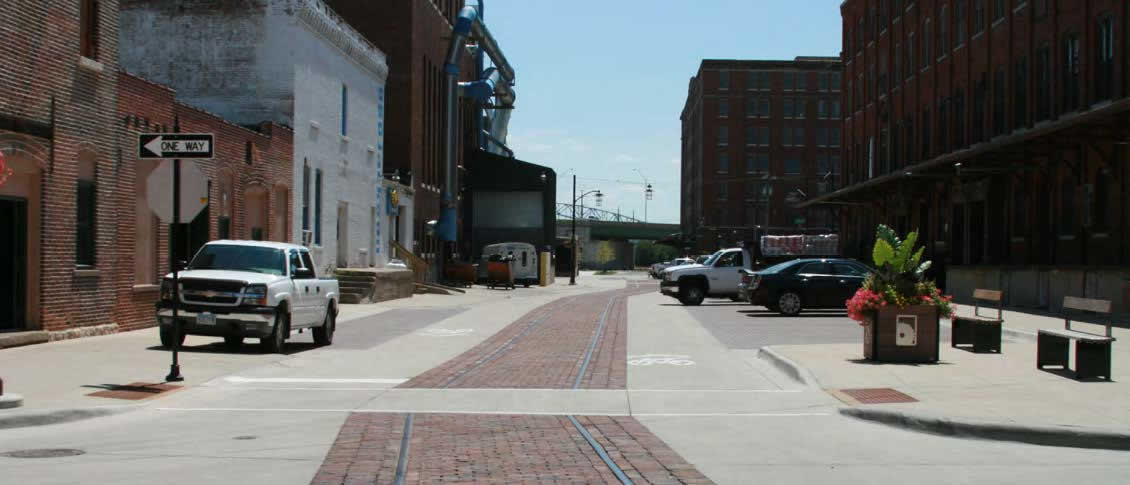 The intersection of 9th Street and Jackson Street is an example of how the city of Dubuque, Iowa accommodated bike, pedestrian and vehicular traffic, while providing room for large trucks to load and unload at docks.