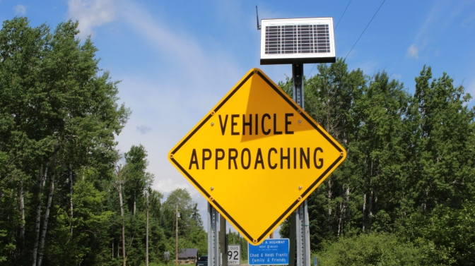 """Vehicle Approaching"" sign"