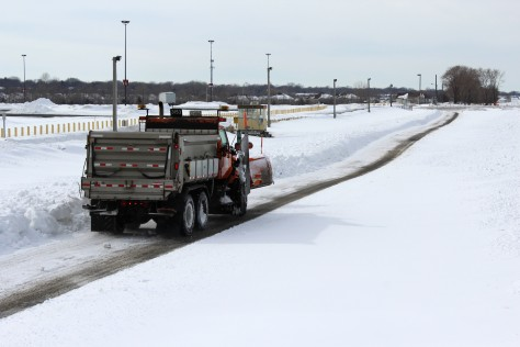 MnDOT snowplow driver John Hokkanen makes a test run at the research site at Canterbury Park.  (Photo by Nick Busse)