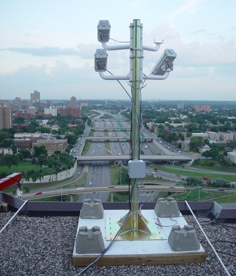 From downtown Minneapolis rooftops, traffic monitoring cameras detect shockwaves on Interstate 94.
