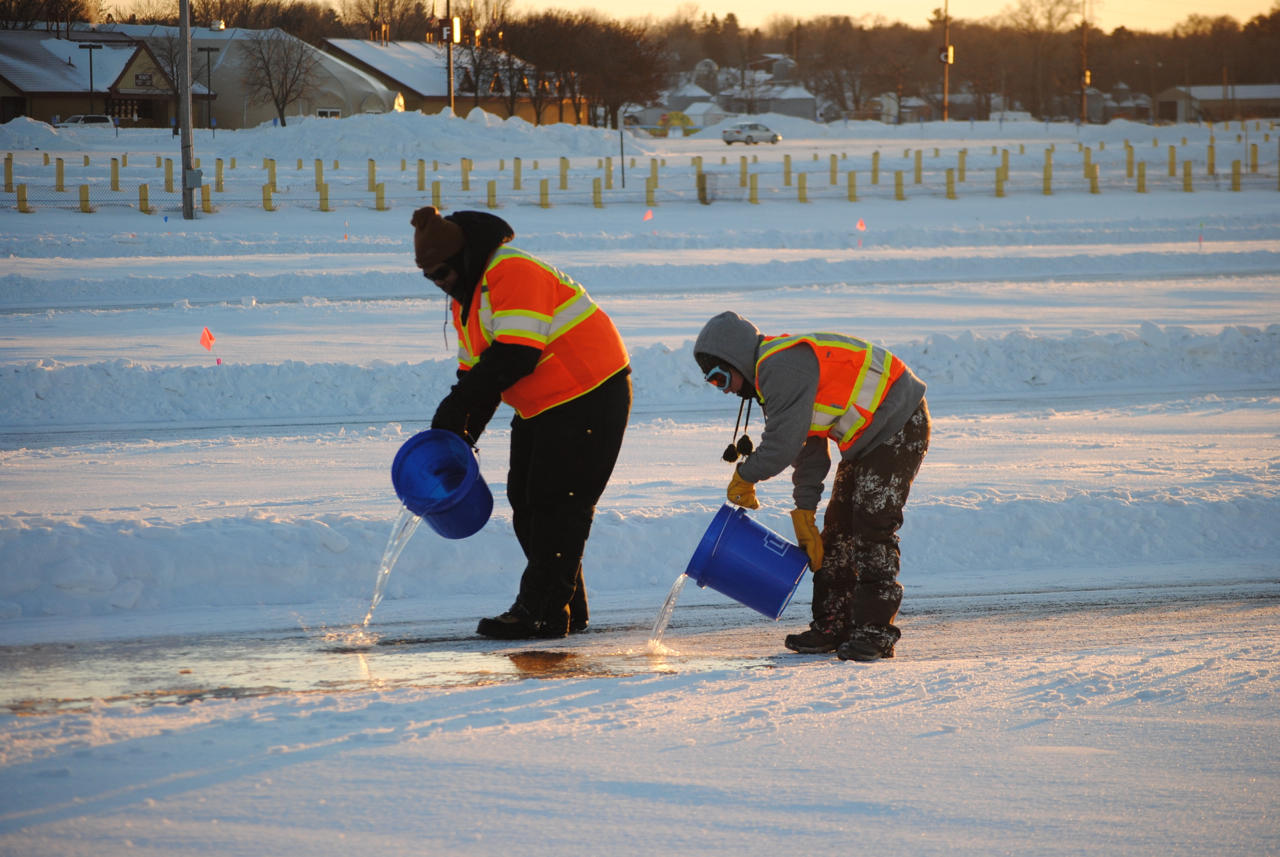 Students pour water to form ice on a test lane in Shakopee.