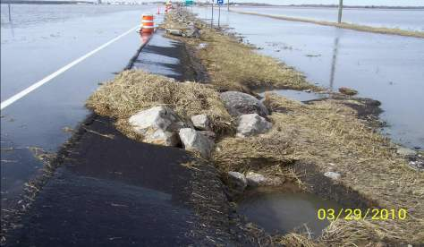 The damage from flooding was less in 2010 after engineers added rocks and vegetation to the side of Highway 9, near Ada.