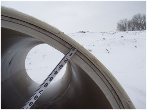 Sliplining, a common culvert rehabilitation method, involves inserting a fiberglass pipe liner (shown) or other material into a deteriorated culvert.