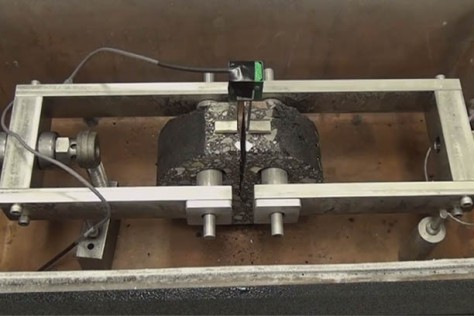 The Disc-Shaped Compact Tension Test measures the fracture energy of asphalt  mixture lab or field specimens, which can be used in performance‐type specifications to control various  forms of cracking.