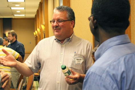 Steve Bower, a Michigan Department of Transportation Research Engineer, visits with MnROAD researcher Bernard Izevbakhai, right, and others during a break.