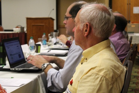 Graig Gilbertson from MnDOT District 8 listens to one of seven presentations Tuesday on the latest research.