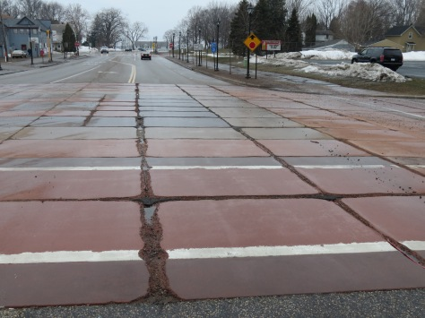The city of Centerville plans to tear up its colored concrete. This photo shows early joint deterioration.