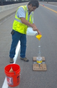 researcher testing permeability of a deck crack on the Smith Avenue Bridge