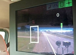 The driver assist system displays a white box on the screen when an obstacle, or in this case a mailbox, is located. If the object appears in the lane, such as a car stuck in a snow drift, the box turns red and gets bigger as the snowplow gets closer to the object. (Photo courtesy of MnDOT District 7)