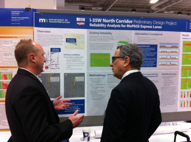 Brad Larsen (left), MnPASS Policy and Planning Program Director, speaks with a conference attendee during a poster session this week at the Transportation Research Board Annual Meeting in Washington, D.C. Larsen was one of two dozen MnDOT employees to deliver presentations at the national transportation research event.