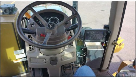 Interior view of mower cab showing location of AVL unit.