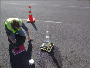 A researcher conducts a test on a pothole