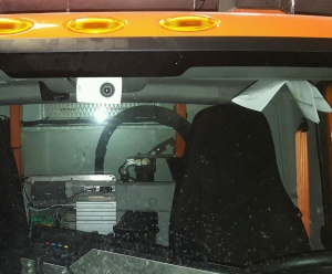 Camera mounted on the ceiling of a MnDOT snowplow cab.