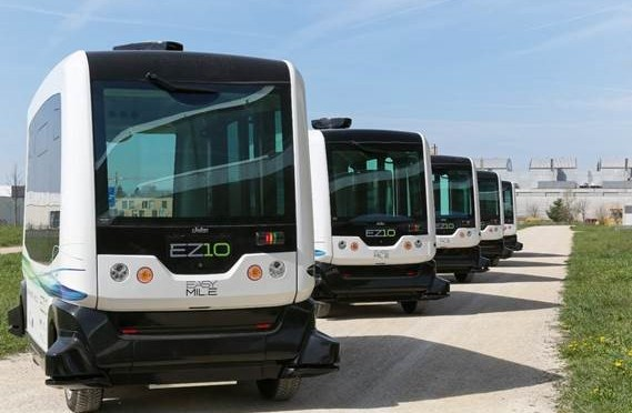 A lin of autonomous shuttle buses
