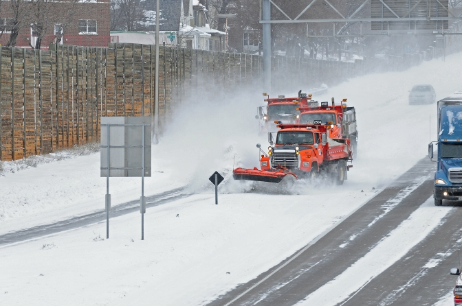 Three snow plows on highway