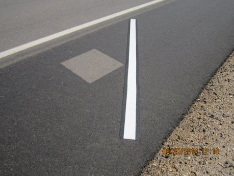 Reflective marking tape on road shoulder