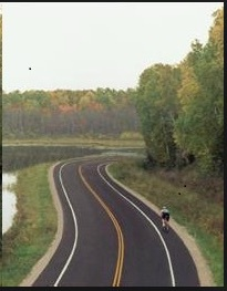 Rural road with cyclist in bike lane