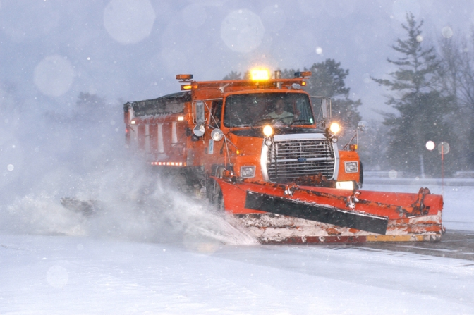 Snowplow vehicle on a snow covered highway