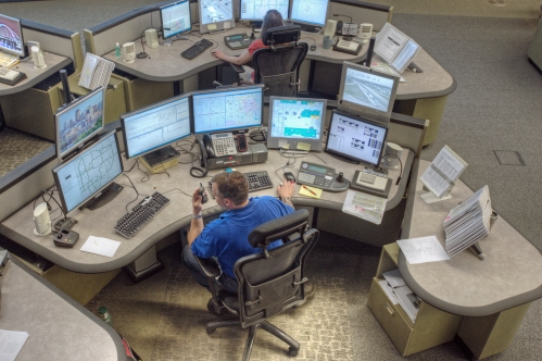 Overhead view of RTMC operator monitoring multiple screens