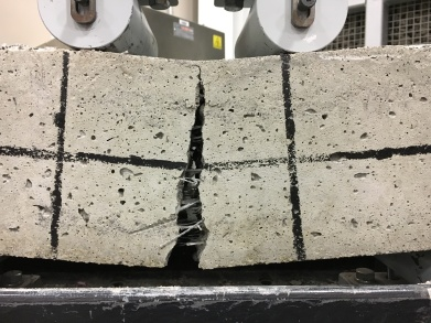 cracked concrete beams with fiber reinforcement