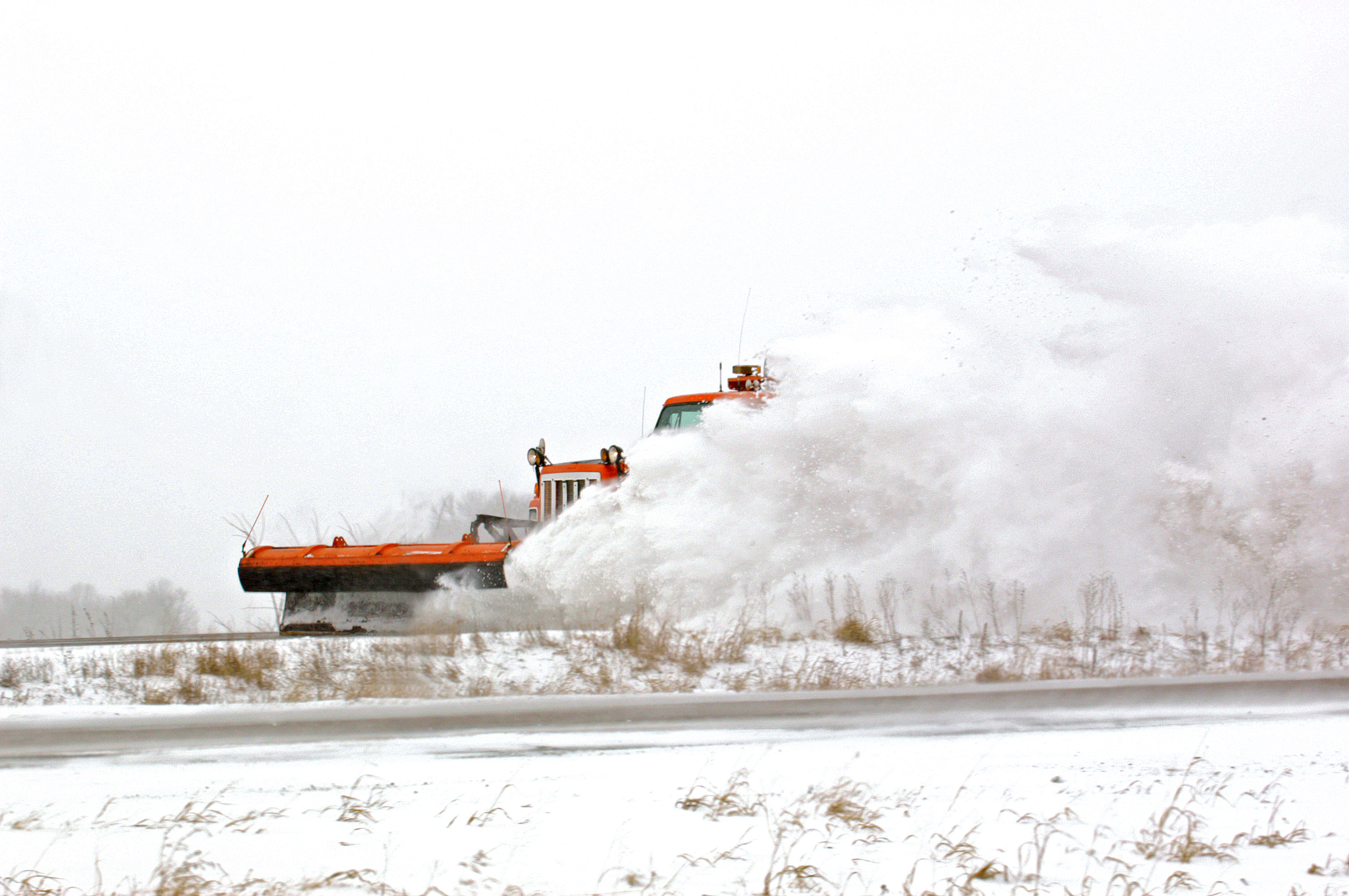 Snowplow on a snowy highway