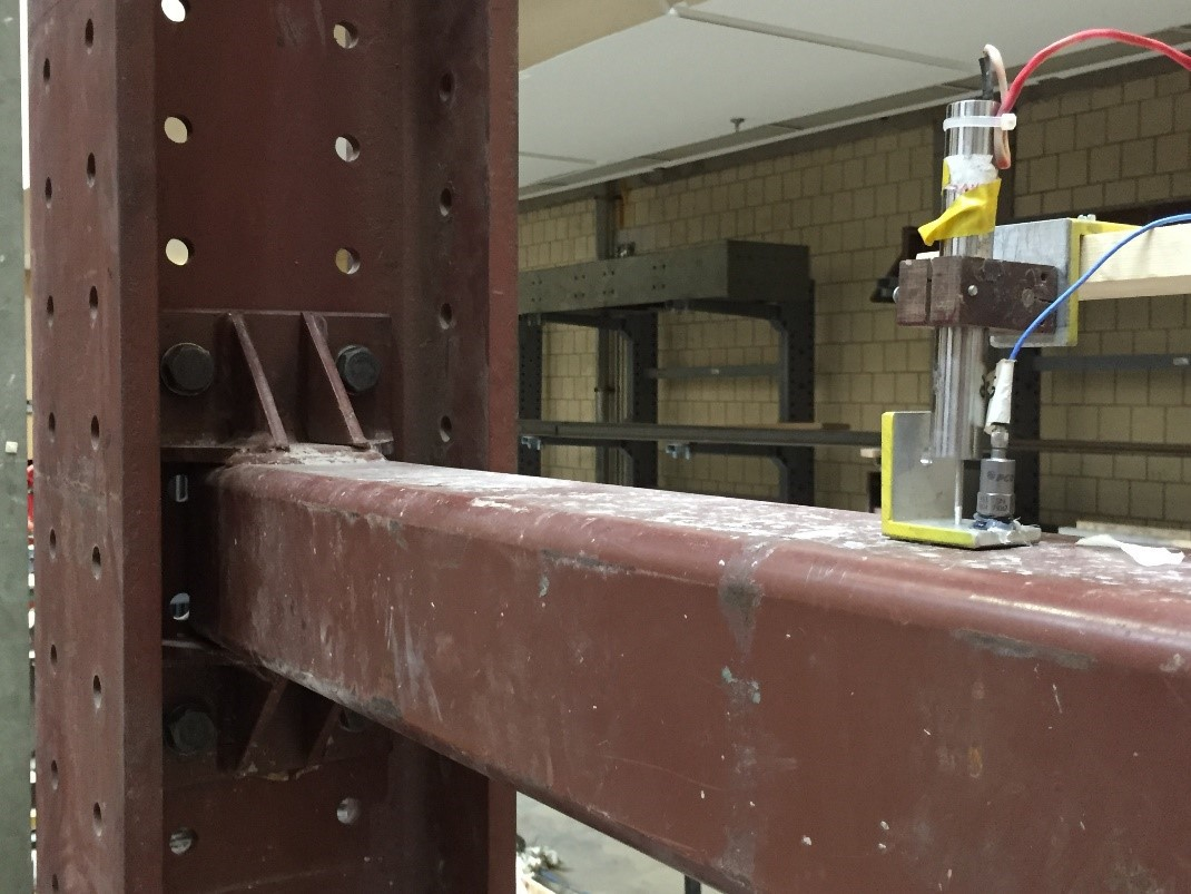 Sensors attached to a steel beam to study vibrations in a laboratory.