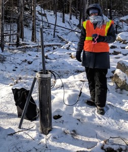 An investigator collects groundwater samples near the construction site.