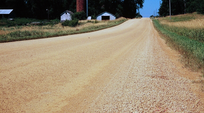 Gravel road running through Minnesota farm country.