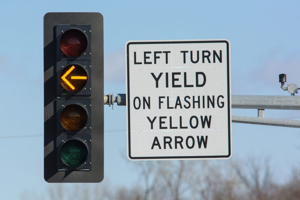 Flashing yellow arrow at intersection.